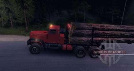 KrAZ madeira caminhão na estrada para Spin Tires